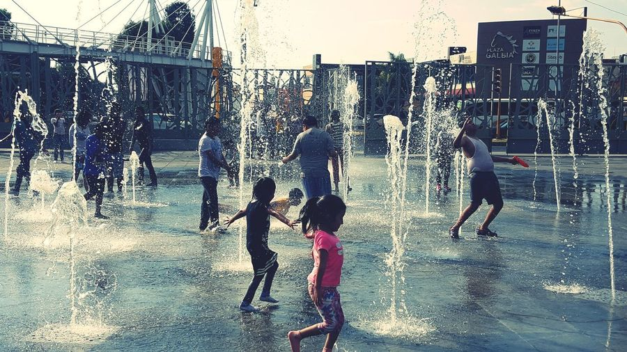 showers Mexico Everyday Mexico Fountain Fountains Fountain_collection Water Water_collection Kids Children Children Photography Children Playing Playing Soaked Clothes Soaked In Water Saturday Water City Men Full Length Wet