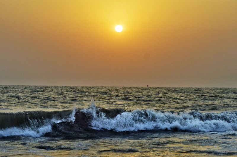 Sunset Sun Sea Beach Horizon Over Water Beauty In Nature Scenics Nature Sky Wave Reflection Water Sunlight Landscape Rock - Object Outdoors No People Idyllic Vacations Tranquility Mumbai BanStand Tajends