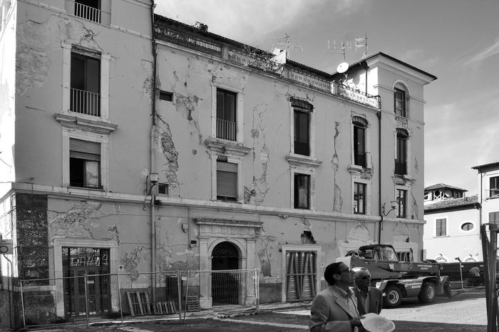 L'Aquila earthquake: damaged palace Abruzzo L'Aquila Architecture Black And White Blackandwhite Building Building Exterior Built Structure City Demaged Earthquake Earthquake In Italy Earthquake L'aquila Italy Men Outdoors Real People Rear View Ruined Building Two People Window