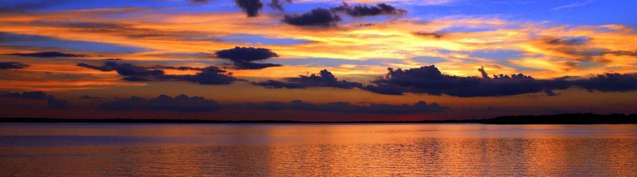 sunset, beauty in nature, scenics, sky, nature, tranquility, tranquil scene, cloud - sky, orange color, outdoors, reflection, no people, water, silhouette, sea, tree, day