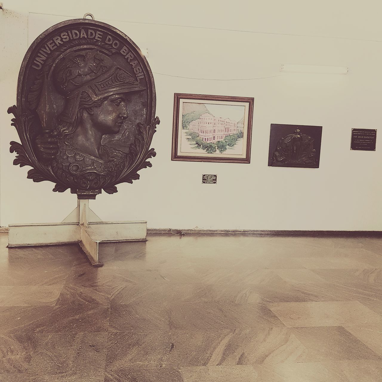 indoors, picture frame, museum, hardwood floor, no people, sculpture, architecture, day