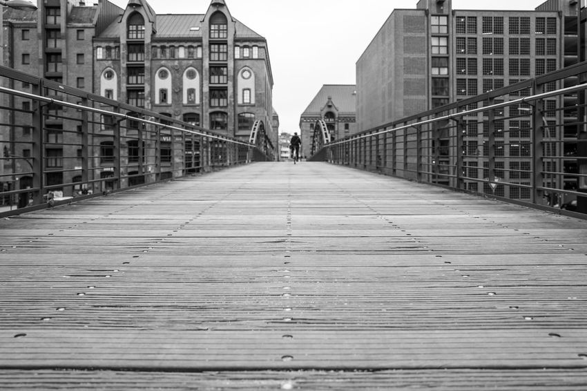 Hamburg Hafencity Hafencity Hamburg Architecture Bridge Bridge - Man Made Structure Building Building Exterior Built Structure City Connection Day Diminishing Perspective Direction Footbridge Footpath Incidental People Long Nature Outdoors Railing Real People Sky Surface Level The Way Forward Walking