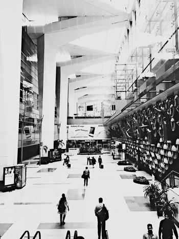 Arrivals and Departures Built Structure Architecture Transportation Large Group Of People Modern People Airport New Delhi IPhoneography Fresh On Eyeem  EyeEmNewHere Blackandwhite Photography Amateurphotography Bnw_captures Modern Snapshots Of Life Life In Motion Shadow And Light