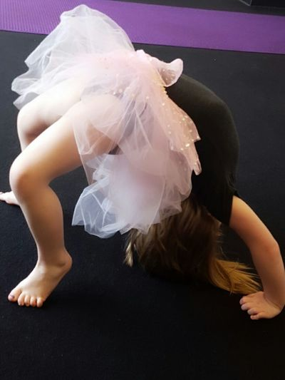 Perfecting a backbend. A first year Acro student.