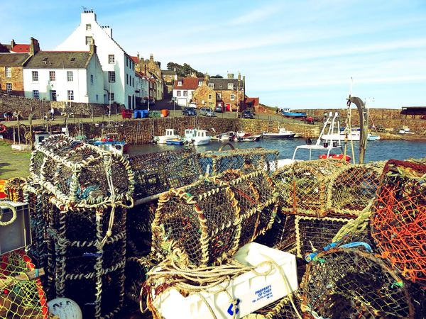Pittenweem harbour at sunset. Architecture Boat Building Exterior Built Structure Day Fishing Equipment Fishing Industry Fishing Net Fishing Tackle Harbor Mode Of Transport Moored Nature Nautical Vessel No People Outdoors Pittenweem Rope Sea Sky Transportation Water