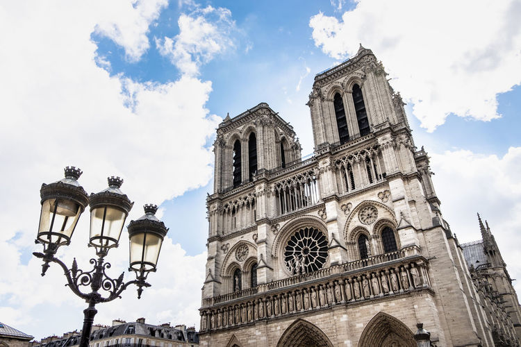 PARIS, FRANCE - MAY 20, 2017. Notre Dame Cathedral in Paris on a bright afternoon in Spring. Ancient catholic cathedral on the quay of a river Seine. Famous touristic architecture landmark. Ancient Arc Arch Architecture Background Basilica Beautiful Bridge Building Capital Cathedral Catholic Christian Church City Cityscape Culture Day Dusk Europe Fame Famous France French Gothic Heritage Lamp Landmark Medieval Monument Notre-Dame Old Paris Quay Reflection Religion River Seine Sight Significant Site Sky Skyline Street Summer Tourism Touristic Tower Travel