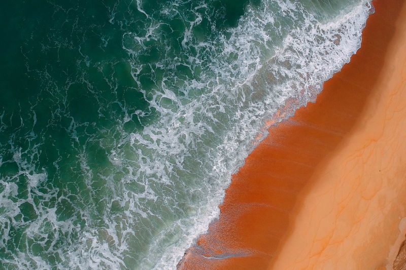 aerial view of sea waves water texture background Sea Motion Water No People Land Beach Wave Beauty In Nature Sport Nature Aquatic Sport Full Frame Outdoors Sand Non-urban Scene Scenics - Nature Day Backgrounds Power In Nature