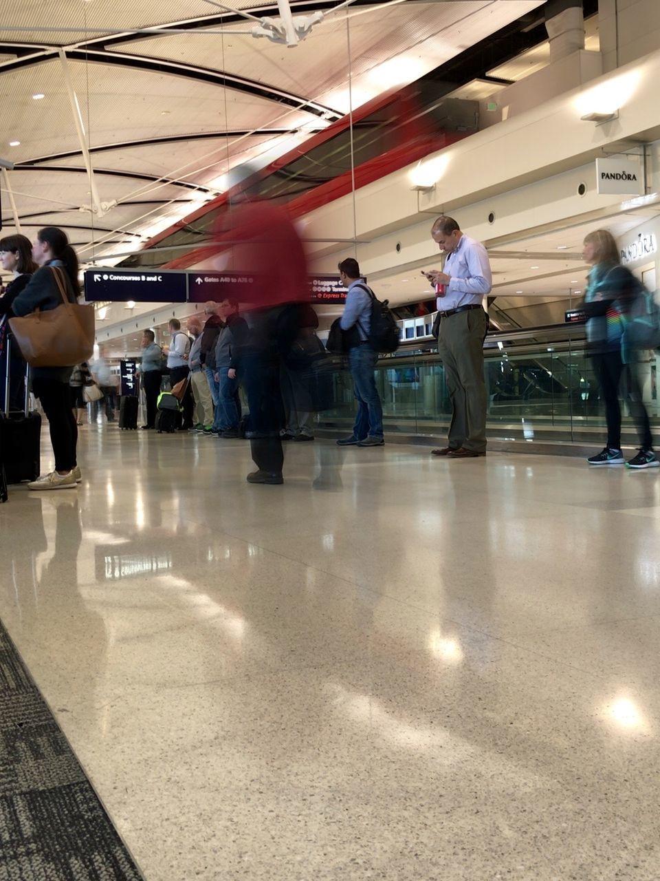 PEOPLE WALKING ON AIRPORT
