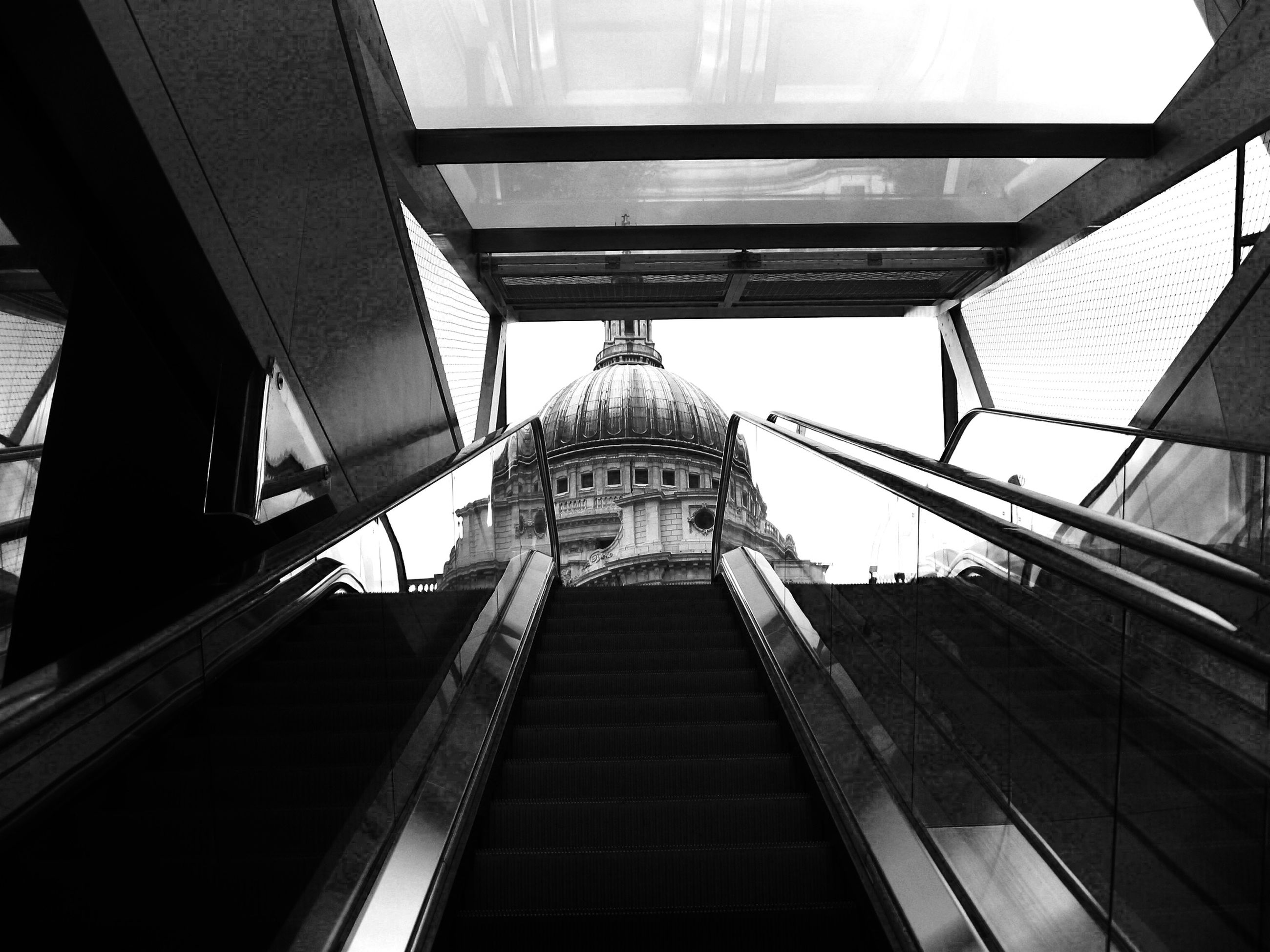 architecture, built structure, low angle view, building exterior, indoors, building, directly below, ceiling, railing, modern, staircase, steps, diminishing perspective, steps and staircases, glass - material, window, architectural feature, day, no people, sky