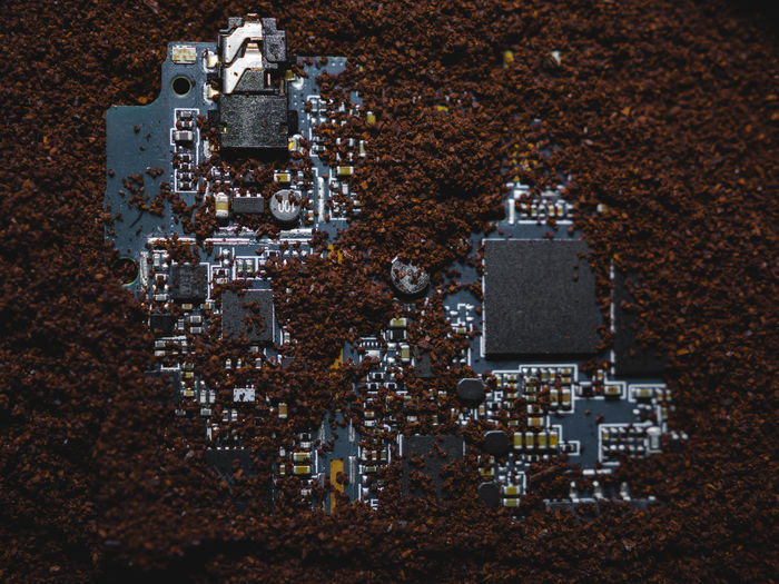 Directly above shot of mother board buried in land