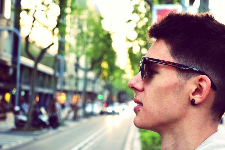 Close-Up Of A Man On City Street