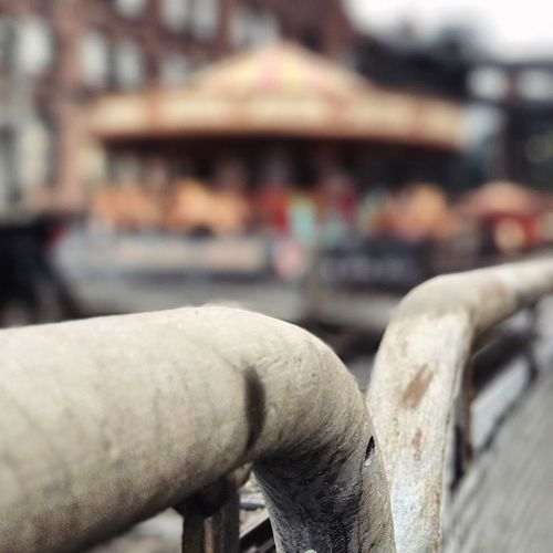 A photo of a fairground in Manchester. The photo has been focused onto railings. The fairground is out of focus in the background Focus On Foreground Outdoors Architecture Fairground Merrygoround Fairground Ride Fairground Attraction Manchester DepthEffects Depth Of Field Focus Deptheffect Mosi Museum Railing Railings Focus Object Foreground Foreground Focus Background Defocus Close-up United Kingdom MerryGoAround Museum Of Science And Industry Saturation