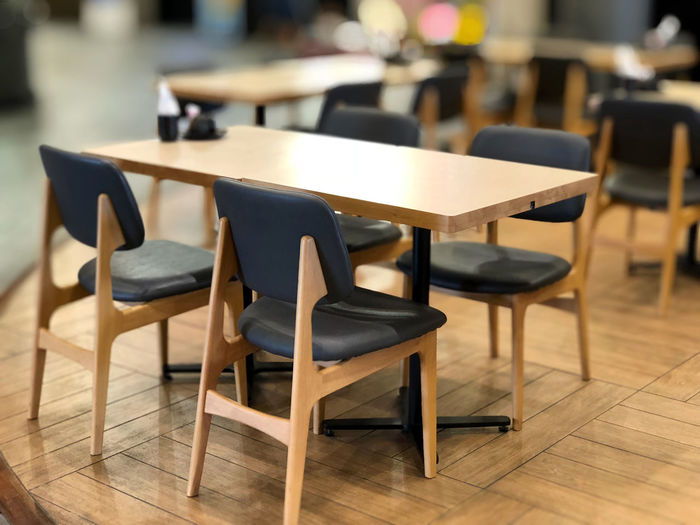 Absence Arrangement Brown Business Chair Education Empty Flooring Focus On Foreground Furniture In A Row Indoors  No People Restaurant School Seat Setting Still Life Table Wood Wood - Material