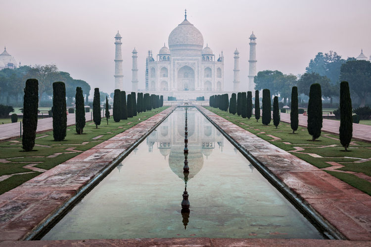 Taj Mahal at sunrise India Agra Architecture Beauty In Nature Day Muslim Natgeo Nature No People Outdoors Reflecting Pool Reflection Sky Tajmahal Travel Destinations Water My Best Photo