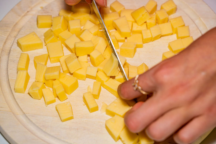 High angle view of man preparing food on cutting board