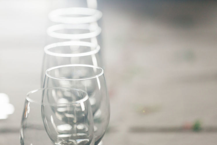 Close-up of empty wineglasses in table