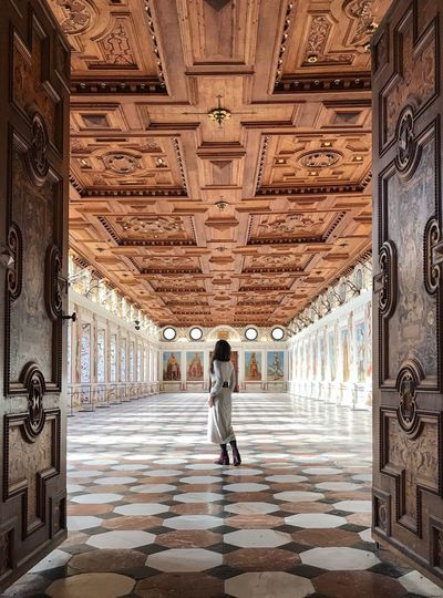 Travel Destinations Doors Building Interior One Woman Only Ball Room Renessaince Castle Ambras Spanish Hall Full Length One Person Travel Destinations Rear View Travel Tourism History Door Indoors  Architecture One Woman Only Vacations Elégance Adult Built Structure Day Adults Only Standing Only Women
