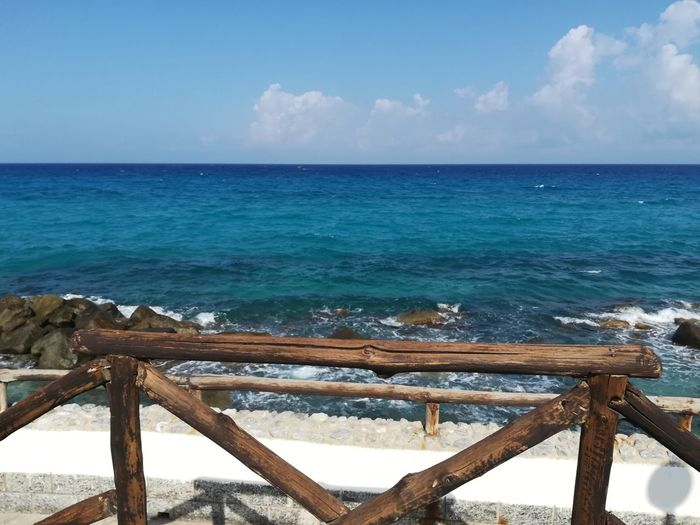 Sea Horizon Over Water Beach Water Sky Tourism Travel Destinations Scenics Vacations Nature Sand Outdoors Tropical Climate Wave Travel Beauty In Nature Blue Wood - Material Horizon Summer