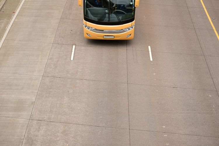 High Angle View Of Yellow Bus On Road