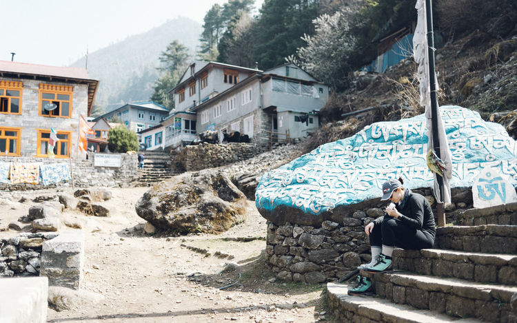 EBC Trek Hiking Nepal The Week on EyeEm Woman Adventure Architecture Blue Building Building Exterior Built Structure Day Full Length Lifestyles Men Nature One Person Outdoors Real People Religion Residential District Rock Rock - Object Sitting Solid Staircase