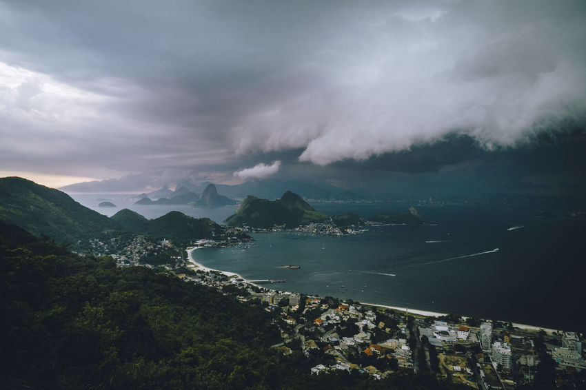 Stormy weather over Rio de Janeiro, Brazil Niterói Rio De Janeiro Stormy Weather Sugar Loaf Weather Bay Beauty In Nature Cloud - Sky Day Guanabara Bay Landscape Mountain Nature No People Outdoors Scenics Sea Sky Storm Cloud Stormy Sunset Thunderstorm Tranquility Water