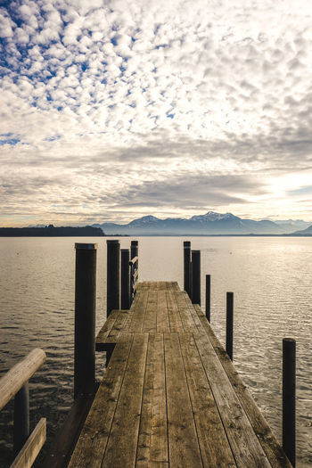 Water Sky Cloud - Sky Wood - Material Pier Scenics - Nature Sea Tranquility Nature Tranquil Scene Beauty In Nature Direction Jetty Wood Outdoors No People Mountain Architecture Wood Paneling Post Wooden Post Long