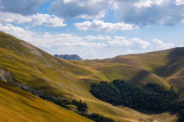Scenic view of landscape against sky in ussita, marche italy