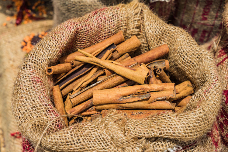 High angle view of cinnamon on in sack market