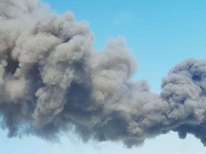 Low angle view of smoke against sky