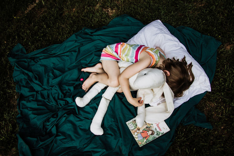Books Reading Storytelling Stuffed Toy Bunny  Child Childhood Color Emotional Golden Book Kid Lying Down Moody Outdoors Real People