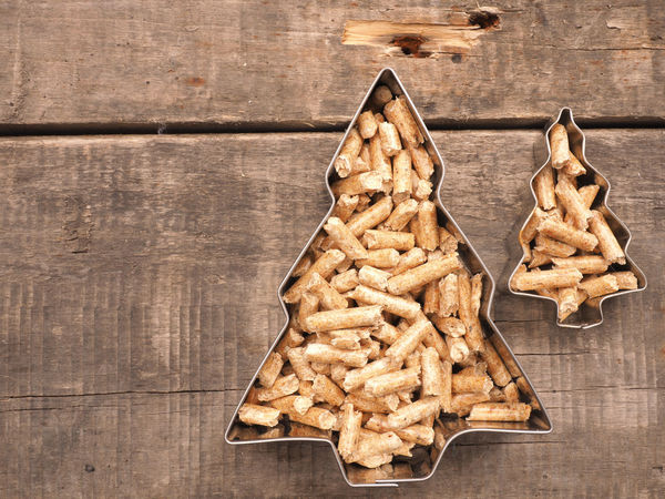 Wooden pellets on a rustic wooden background with tree shapes, alternative energy concept CO2 Emissions Concepts Eco Natural Rustic Wood Alternative Energy Biological Climate Ecology Environmental Conservation Heating Costs Heating Period Heating System Material Pellets Protection Tree Shape Wooden