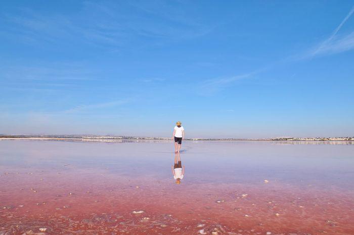 Man Nature SPAIN Salt SaltLake Torrevieja Travel Traveling Weird Beach Beauty In Nature Blue Sky Cool Places Hats One Person Outdoors Pinklake Rear View Salt - Mineral Salt Flat Saltwater Scenics Sky Spaın Water