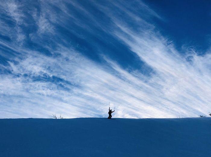 Man on snowcapped mountain against sky