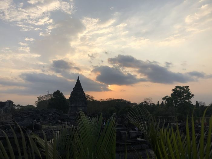 Panoramic view of temple against sky during sunset