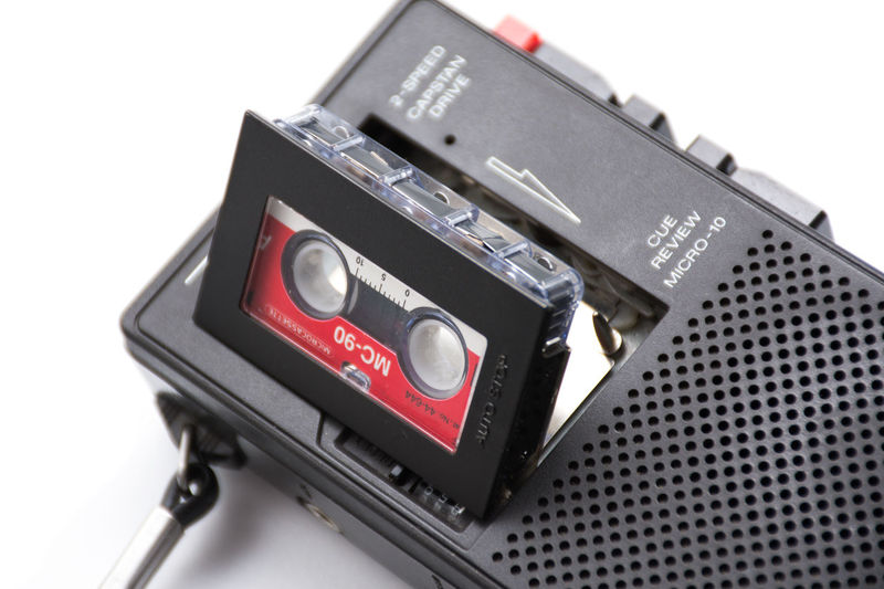 Micro cassette tape in a dictation recorder White Background Technology Studio Shot Black Color Close-up Equipment Indoors  No People Communication Electronics Industry Retro Styled Connection Sound Recording Equipment Electrical Equipment Compact Cassette Cassette Dictation Micro Cassette