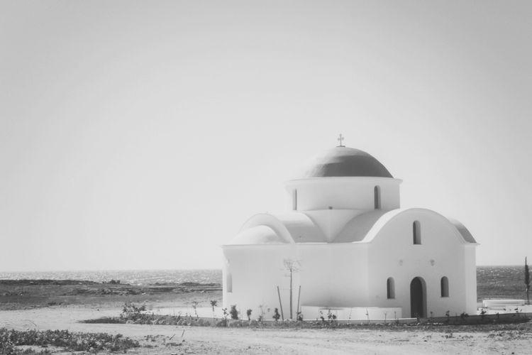 Orthodox Church On Plane Overlooking Calm Sea