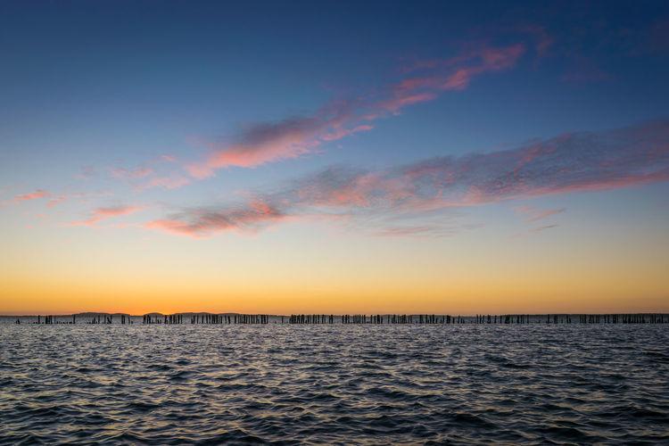 Sunset at Großer Jasmunder Bodden Sky Sunset Water Sea Tranquility Beauty In Nature Nature Idyllic Outdoors Sundown Dusk Twilight Großer Jasmunder Bodden Bodden Rügen Ruegen Jasmund Europe Germany