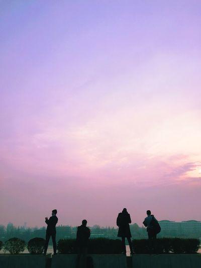 Silhouette people walking on landscape
