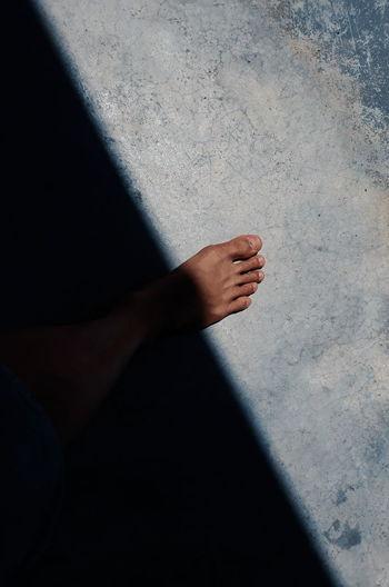 Close-up of human leg on flooring
