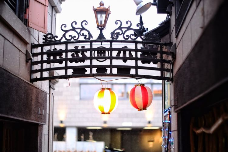 Illuminated lanterns hanging in building