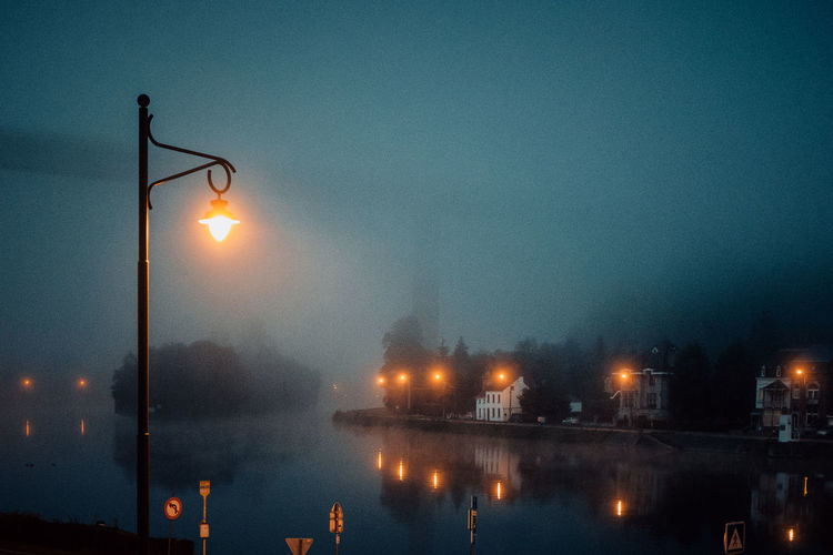 Ardennes Atmospheric Mood darkness and light Dark Eerie Beautiful Ardennen Belgium Mist Misty Morning Illuminated Water Sky Night Street Light Lighting Equipment Building Exterior Architecture No People Reflection Built Structure Nature Street River Waterfront City Light Dusk Glowing Outdoors Electricity