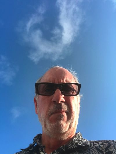 Grumpy man with cloud over his head. Angry Grumpy Adult Beard Blue Cloud - Sky Cloud Over Head Day Glasses Human Face Low Angle View Males  Mature Adult Mature Men Men Middle Aged Man Outdoors Portrait Sunglasses
