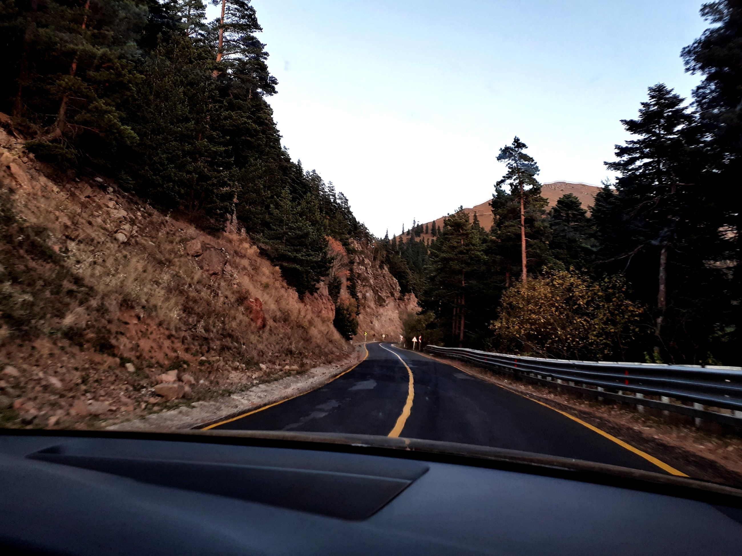 transportation, car, mode of transportation, tree, motor vehicle, transparent, plant, land vehicle, road, sky, vehicle interior, glass - material, windshield, nature, car interior, no people, travel, on the move, mountain, day, outdoors, car point of view