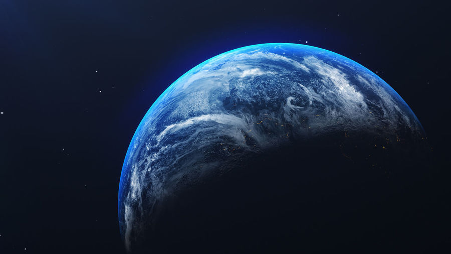 Close-up of earth against blue sky at night