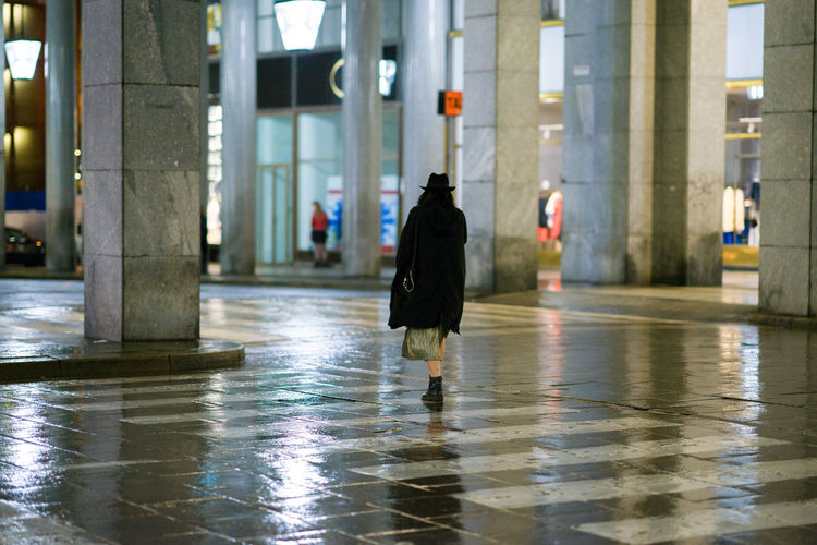Rainy night in the city of turin Torino City Reflection Waterfront Black Color Focus On Foreground Outdoors Full Length Architectural Column Walking Rear View Built Structure Real People Day One Person Water Architecture Mirkomacaritorino