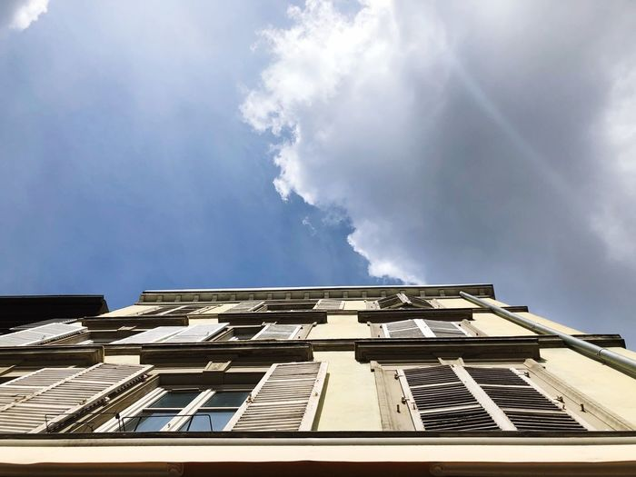Sky Building Exterior Cloud - Sky Low Angle View Architecture Built Structure Go Higher Building Sunlight Day No People City Outdoors House Directly Below Residential District Window