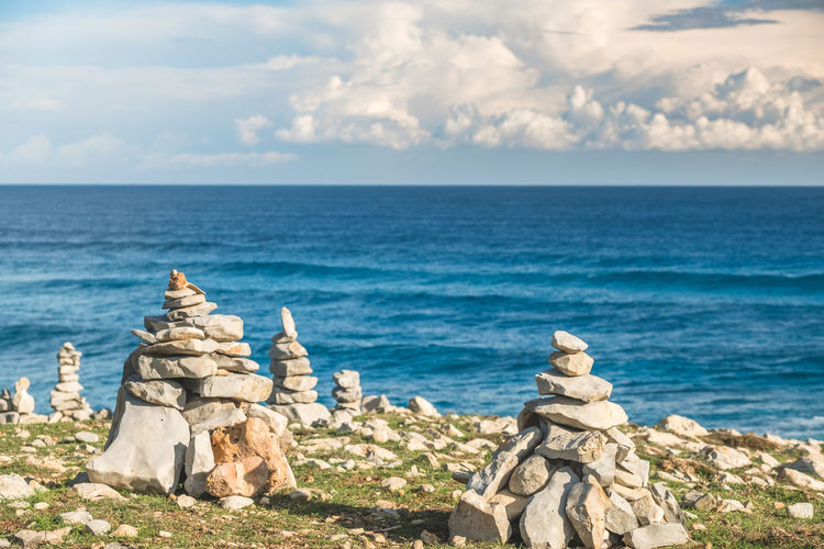 Art And Craft Balearic Islands Beach Beauty In Nature Cliff Cloud - Sky Day Horizon Over Water Majorca Mediterranean Sea Nature No People Outdoors Rock - Object Scenics Sculpture Sea Sky Spirituality Statue Summer Tranquility Water