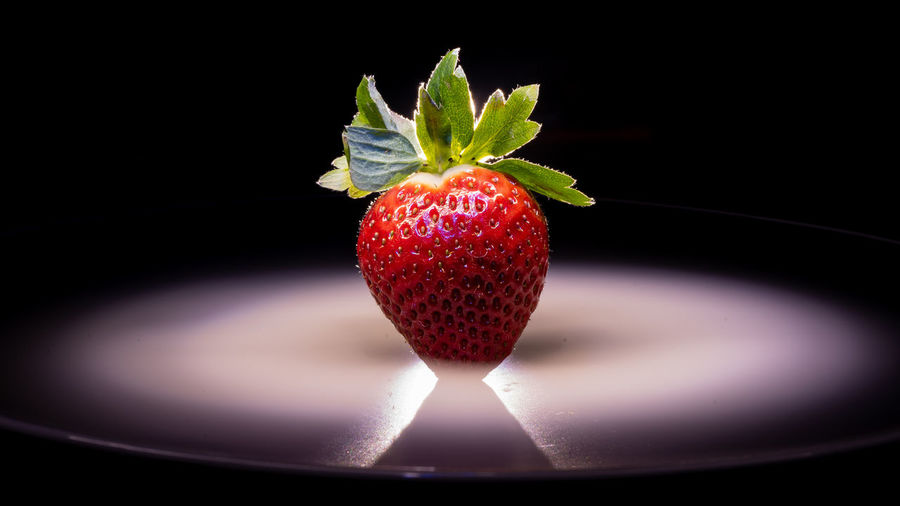 Fruity Lone Strawberry Strawberry On A Plate Black Background Fruit Studio Shot Frozen Food Red Strawberry Colored Background Close-up Sweet Food Food And Drink Berry Fruit Dessert Served