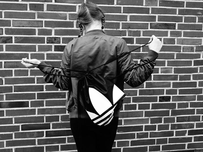 Brick Wall Rear View Only Men One Person Outdoors Adult Real People Men People Day One Man Only Girl Girl Power Girl Portrait Blackandwhite People Photography People Of EyeEm Bnwphotography Bnw Portrait Adidas Adidas Originals EyeEm Best Shots EyeEm Gallery Portrait Fashion