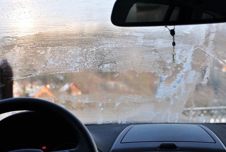 Wet car window in rainy season